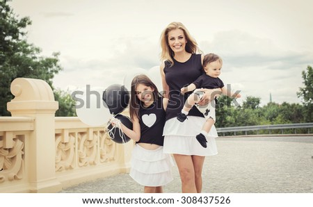 mother with children having a fun with balloons - stock photo