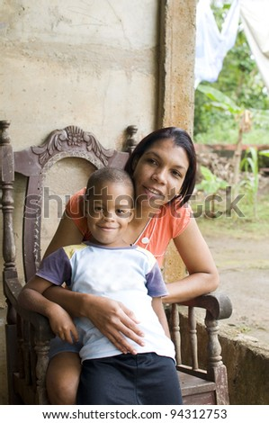 mother with children house Nicaragua Corn Island - stock photo