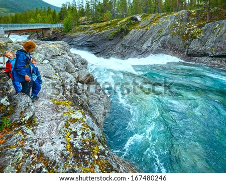 Mother with children near mountain river waterfalls (Ottafossen, Norge )   - stock photo