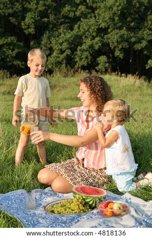 mother with children on picnic
