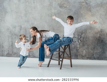 Mother with children sons happy studio portrait full length