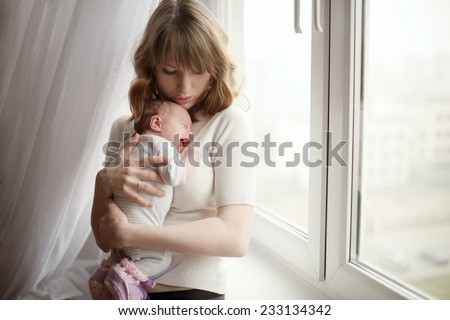mother with cute little crying baby - stock photo