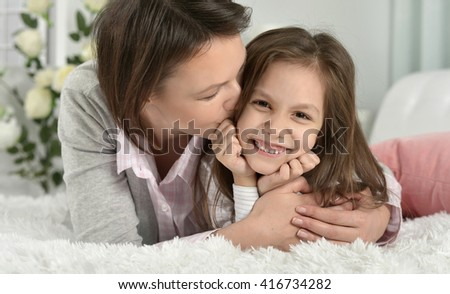 Mother with daughter  at home - stock photo