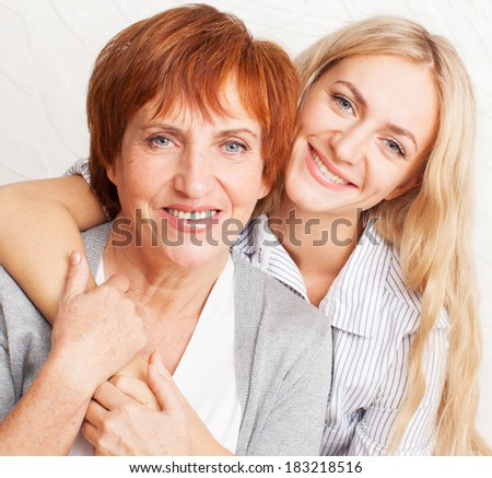 Mother with daughter at home. Portrait family - stock photo