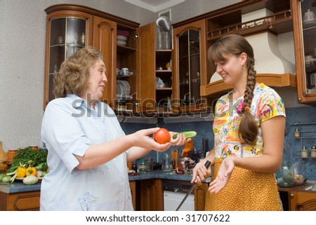 Mother with daughter cooking in the kitchen