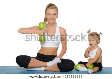 Mother with daughter train weights of green apples - stock photo