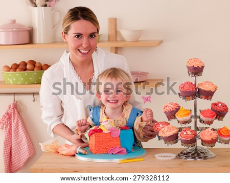 Mother with Daughters decorating cakes
