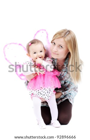 mother with her baby girl in pink butterfly outfit - stock photo