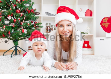 Mother with her beautiful baby boy celebrating Christmas