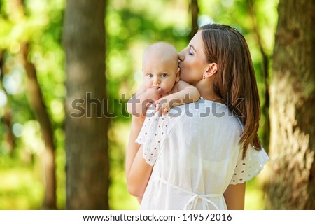 Mother with her child take rest in park