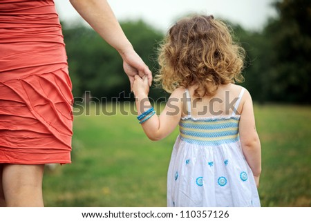 Mother with her daughter are going to a walk - stock photo