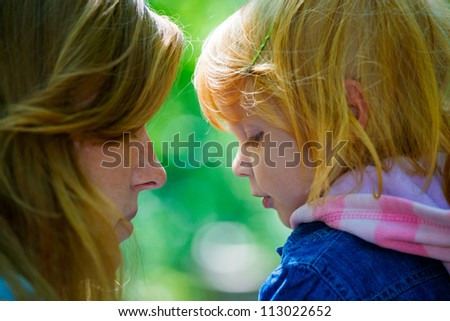 Mother with her daughter outdoors in the park - stock photo