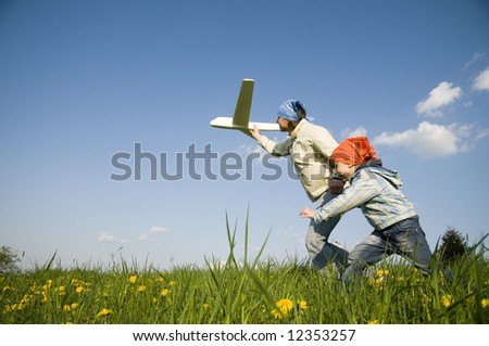 Mother with her daughter with plane model - stock photo