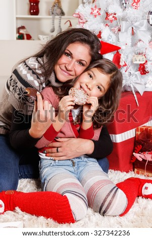 Mother with her little daughter at Christmas