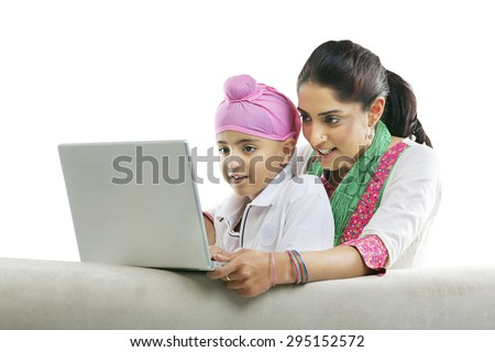 Mother with her son looking at a laptop