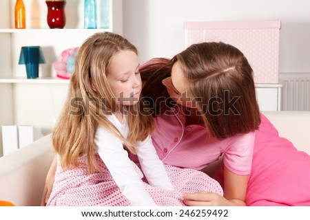 Mother with ill child at home - stock photo