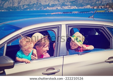 mother with kids travel by car on sea vacation