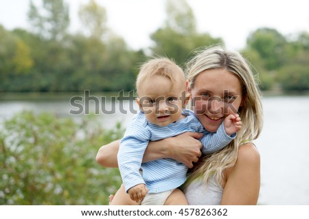 Mother with little baby boy at the park. Happy family. Positive human emotions, feelings,joy. Funny cute child making vacations and enjoying summer. Spring and summer holidays