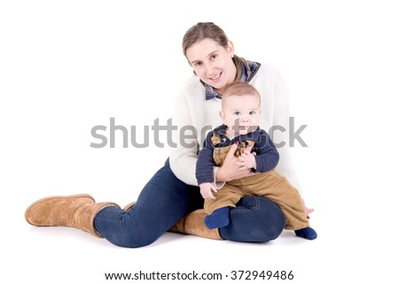mother with little baby isolated in white - stock photo