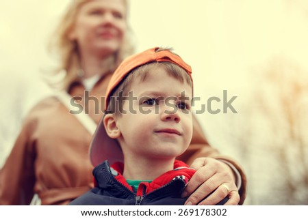 Mother with little boy in vintage style, outdoor portrait, Mother's day - stock photo