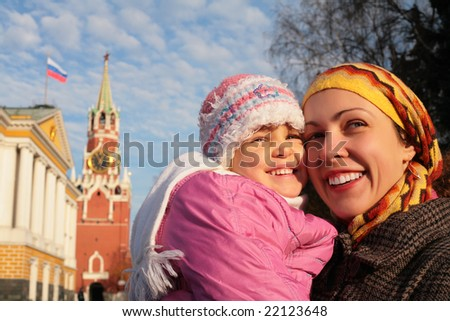 mother with little girl in Kremlin faces - stock photo