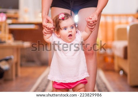 mother with little girl walk in the room - stock photo