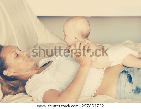 Mother with new born baby - stock photo