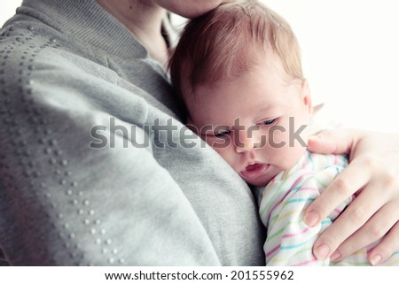 Mother with newborn baby - stock photo