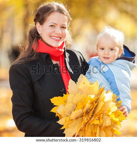 Mother with son in the autumn park - stock photo