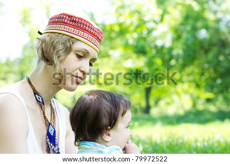 Mother with son relaxing at the park - stock photo