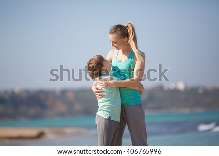 Mother with son resting on the beach at morning