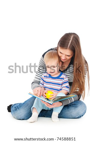 mother with son sitting on floor and reading book - stock photo