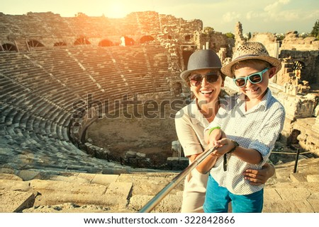 Mother with son take a selfie photo in antique theatre - stock photo