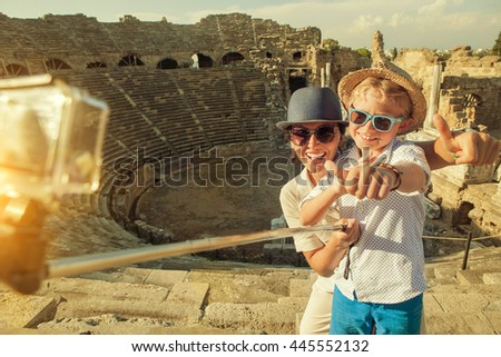 Mother with son take a vacation photo on the Side ampitheatre view - stock photo