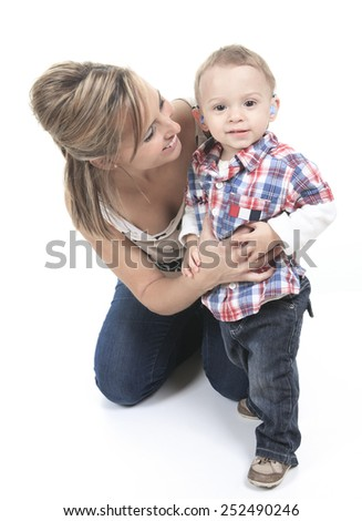 Mother with son. The kid have a Hearing Aids. - stock photo