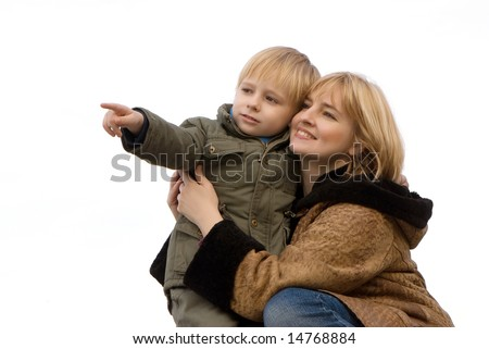 Mother with the son on a light background. A winter season. - stock photo