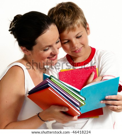 Mother with the son reading the book - stock photo