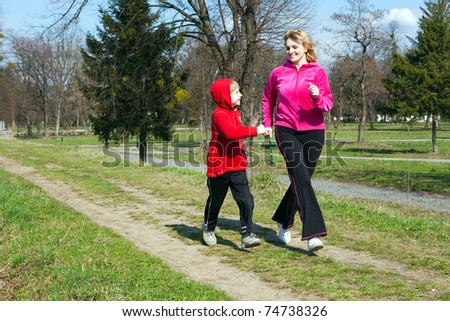 Mother with the son running on park - stock photo