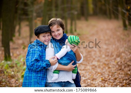 Mother with their children - teenager boy and newborn