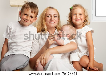 Mother with three children at home