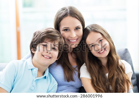 Mother with two children  - stock photo