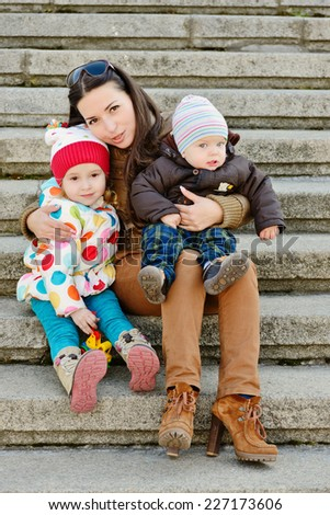 mother with two children outdoors - stock photo