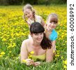 Mother with two daughter in outdoor. Happy family. - stock photo