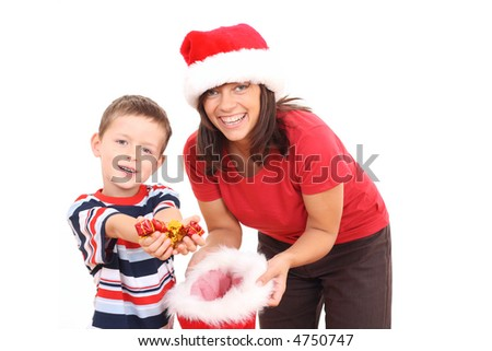 mother 5-6 years old son having fun in Christmas hats isolated on white