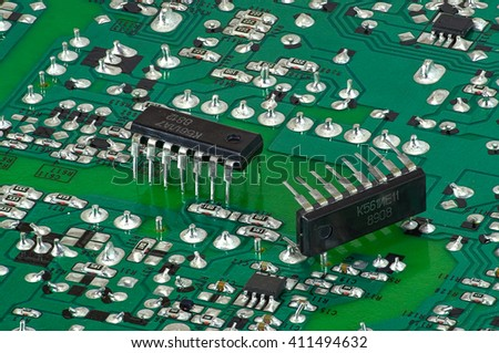 Motherboard with parts close up for the manufacture of electronic devices - stock photo