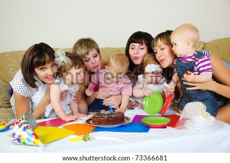 Mothers and their children gathered together to have fun. Children's Holiday - stock photo
