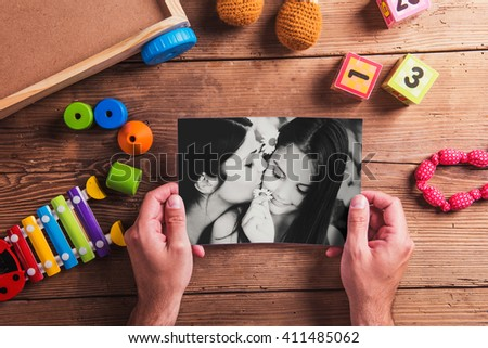 Mothers day composition. Black-and-white photo. Various toys. Wo