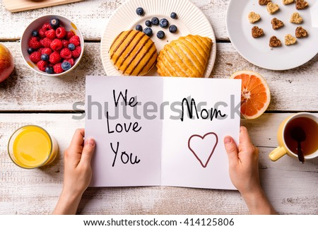 Mothers day composition. Greeting card and breakfast meal. - stock photo