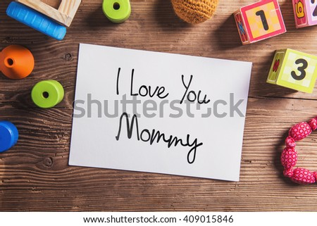 Mothers day composition, various toys. Studio shot, wooden, back - stock photo