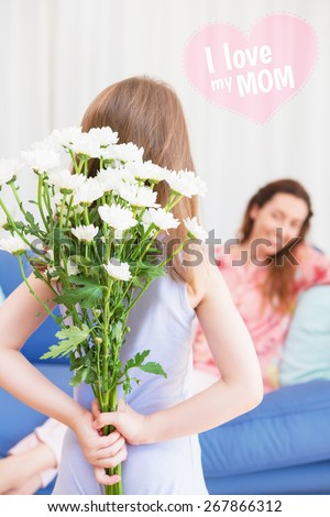 mothers day greeting against daughter surprising mother with flowers - stock photo